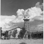 Amache water tower and barracks photo