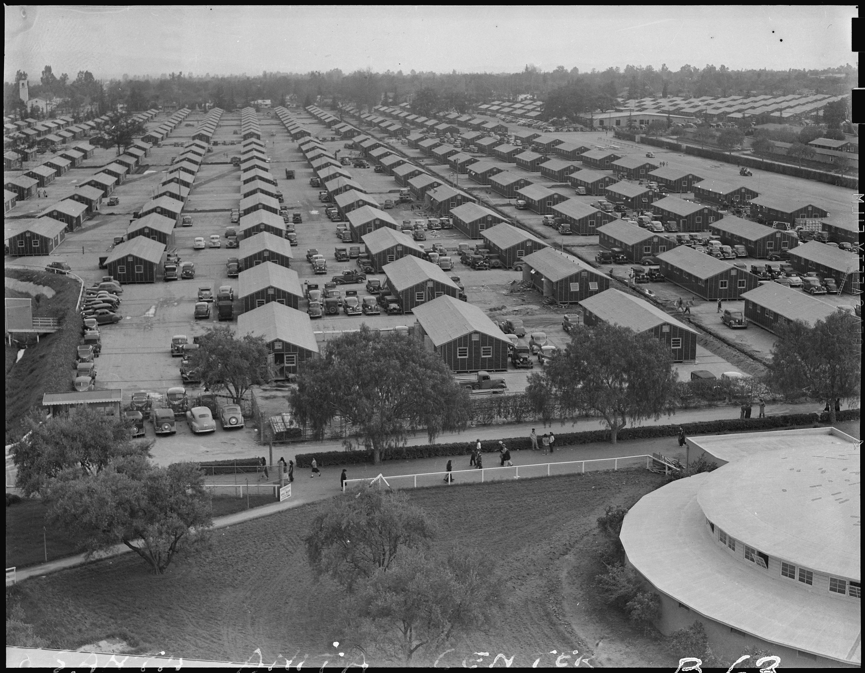 Santa Anita Assembly Center, Arcadia, California. A panoramic view of the Santa Anita assembly center where evacuees from this section await transfer to War Relocation Authority centers to spend the duration. Photo by Clem Albers (NARA record: 8452194).