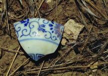 Teapot lid fragment at Amache. Photo courtesy DU Amache Project.