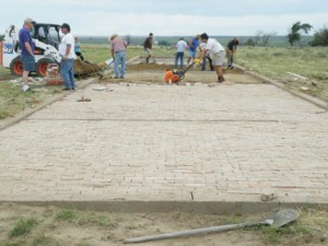 Volunteers laying bricks. Photo courtesy Amache Preservation Society.